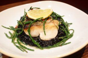 Fillet of Hake with Squid Ink Risotto and Samphire